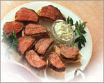 Marinated Fillet of Beef with Herb Dressing on Crusty Bread
